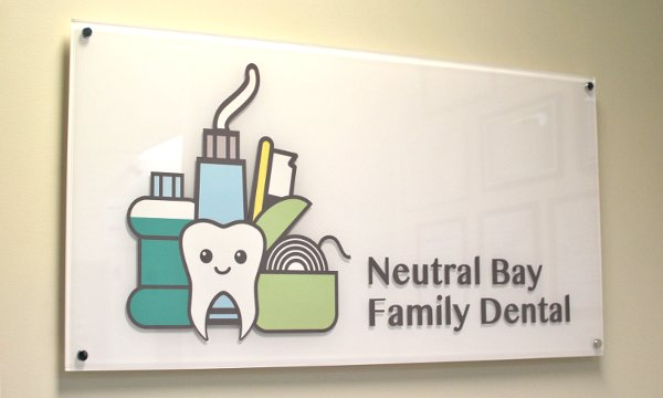 Neutral Bay Family Dental sign and logo